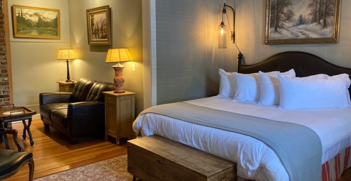 Room 15 – The Library Suite's King bed and entrance to sitting room