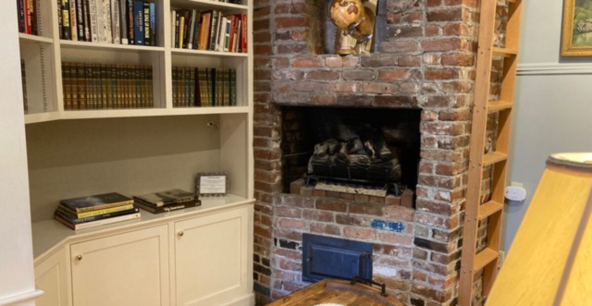 Room 15 – The Library Suite's fireplace and bookshelves